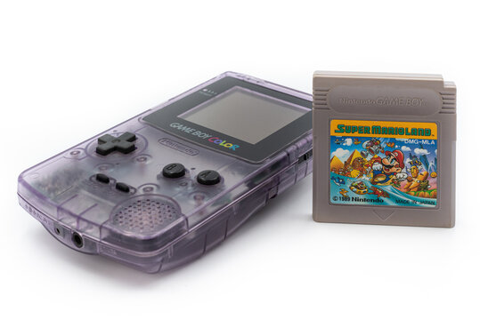 Fukuoka, Japan - june 23, 2019 : the famous nintendo game boy color portable console with Super Mario Land cartridge