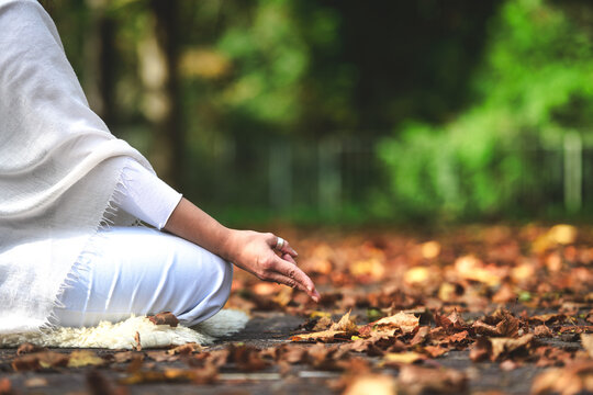 Yoga position during a session in the autumn nature