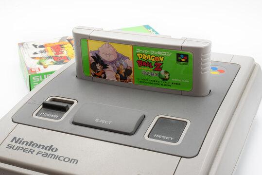 Fukuoka, Japan - may 1, 2019 : the 1990's fighting game Dragon Ball Z: Super Butōden 3 cartridge plugged in the original Nintendo Super Famicom