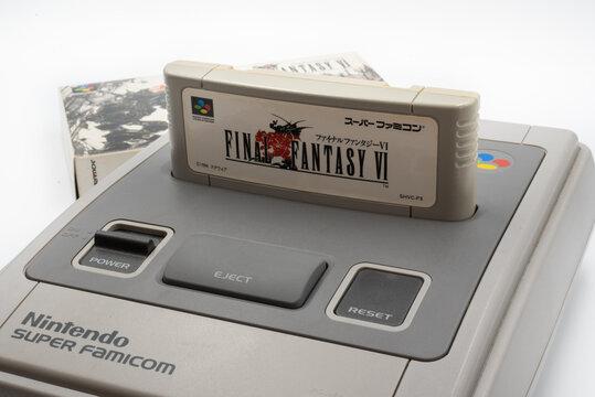 Fukuoka, Japan - may 1, 2019 : the famous squaresoft 1990's hit final fantasy VI cartridge plugged into the original Nintendo Super Famicom