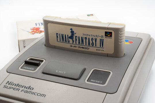 Fukuoka, Japan - may 1, 2019 : the famous squaresoft 1990's hit final fantasy IV cartridge plugged into the original Nintendo Super Famicom