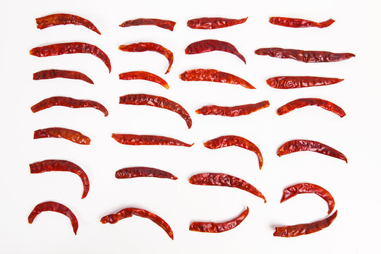 Dried red pepper on white background.