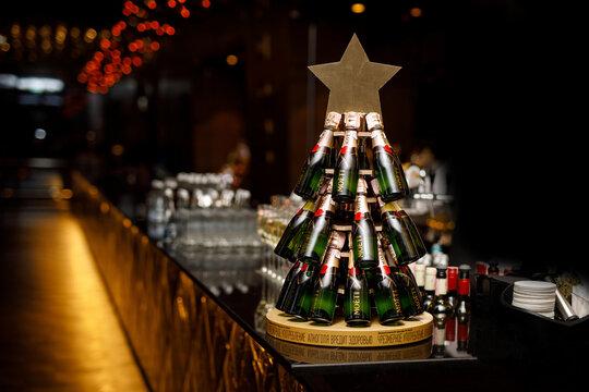 "24.12.19 - Minsk, Belarus: Champagne bottles ""Moet"" in the form of a Christmas tree."