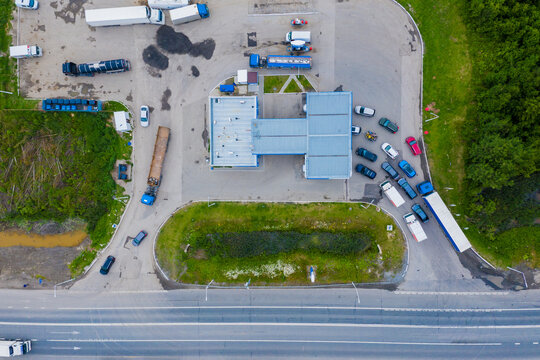 Aerial view of green gas station in the city near the road for cars. The concept of increasing the cost of gasoline and diesel.