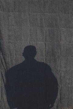 Shadow Of Man On Blue Backdrop