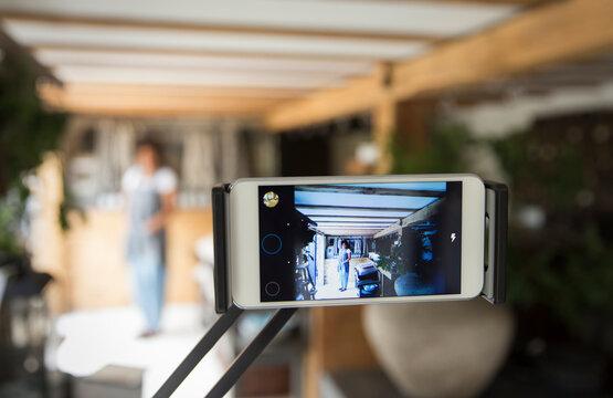 Smart phone screen business owner filming vlog in plant nursery