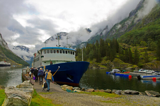 Boarding tour boat for ride on Sognefjord fjord, Norway