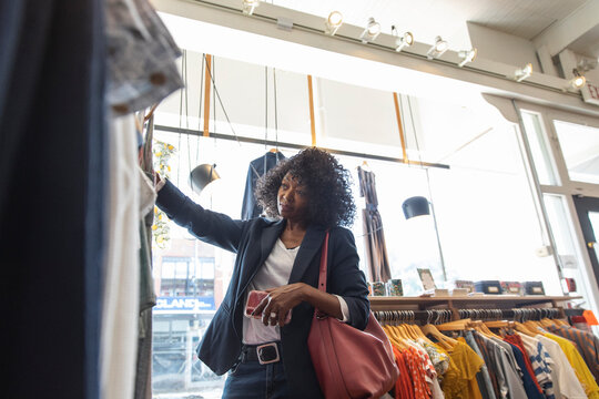 Woman shopping for clothing in boutique