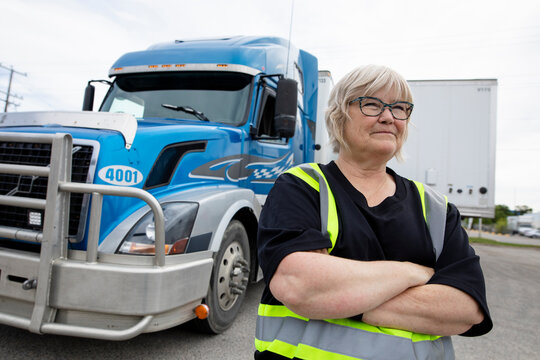 Portrait of warehouse owner in front of container semi truck
