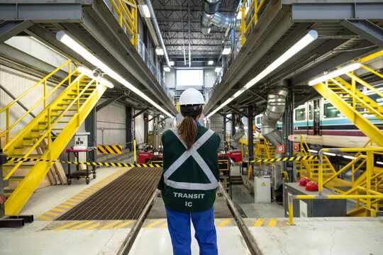 Female transit worker in maintenance facility