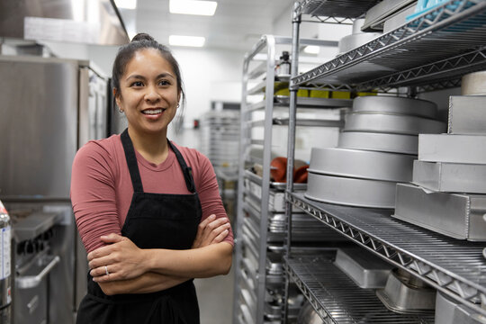 Portrait of mid adult woman in catering kitchen