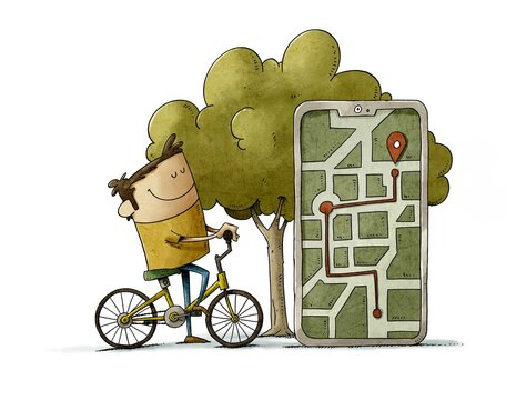 man on a bicycle checks their location on their mobile. isolated
