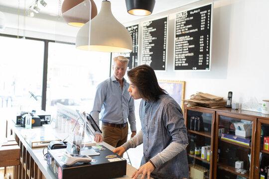 Male workers behind counter in marijuana dispensary