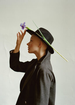 Beautiful portrait of a young bald girl in a coat and hat