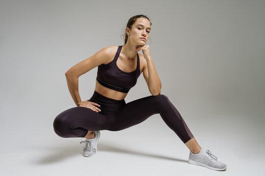 Slim sportswoman looking at camera