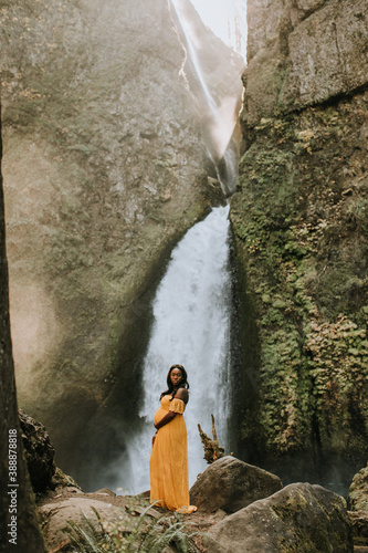 Beautiful Pregnant, Black Woman in front of Oregon Waterfall