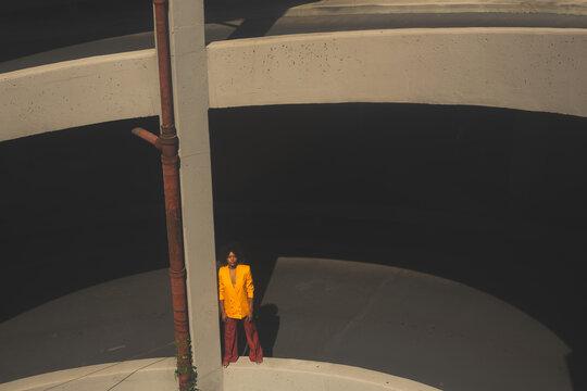 Woman Standing In Parking Garage