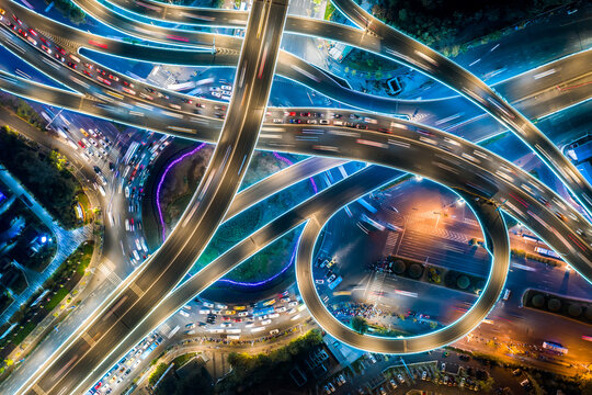 Express way night traffic top view. Road roundabout