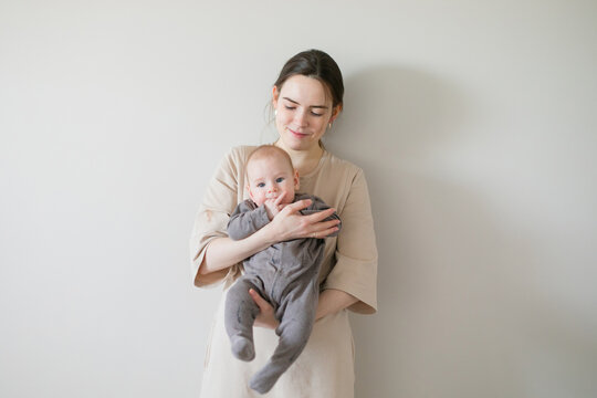 stock photo of mom and baby on a pastel background