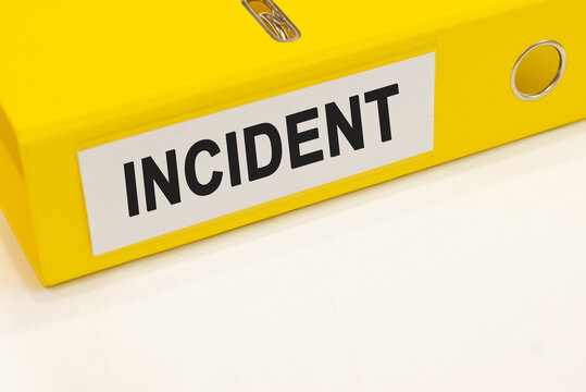 The word incident on a white background with a yellow folder. Business concept