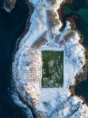 Green football field on the island in winter, Norway
