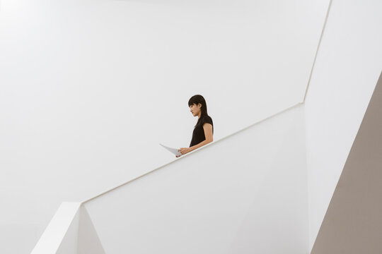 a business woman walking on the stairs