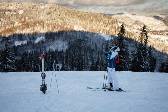 Ski resort among snowy Carpathian mountain.