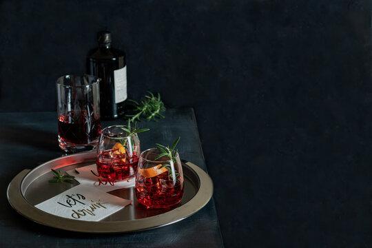 Classic Negroni cocktail with smoked rosemary garnish