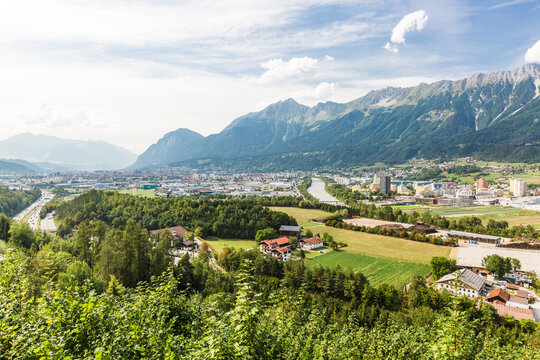 Austria, Tyrol, Innsbruck, City on�River Inn�in summer with mountains in background
