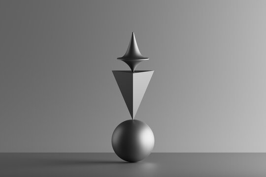 Three dimensional render of metallic top spinning on top of geometric pyramid and sphere