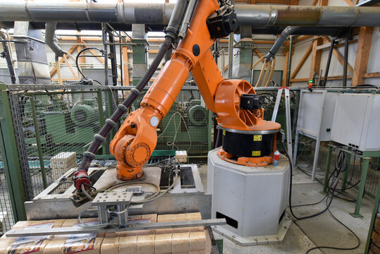 Robotic arm operating in modern lumberyard