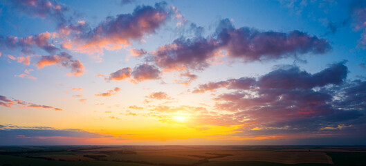 Wall Mural - Fantastic colorful sunset with cloudy sky. Photo of textured sky.