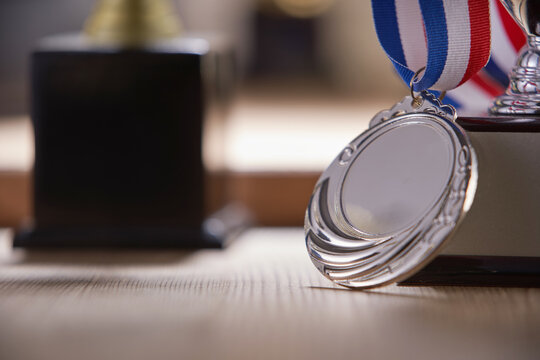 close up of the silver medal with trophy