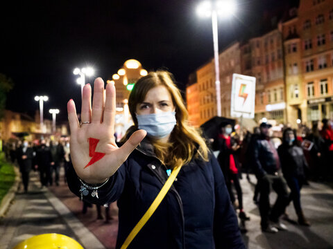 Polish Woman has drawn a sign red lightning on her hand. Women Protest against tightening of the abortion law in Poland.