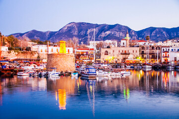 Blue hour view in Kyrenia harbour on . Kyrenia harbor is a famous tourist resort.