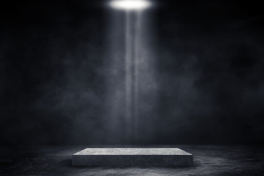 Empty space of Studio dark room with concrete stone stage or podium and spot lighting and fog or mist on concrete floor grunge texture in background.