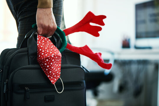 man with briefcase, mask and reindeer headband