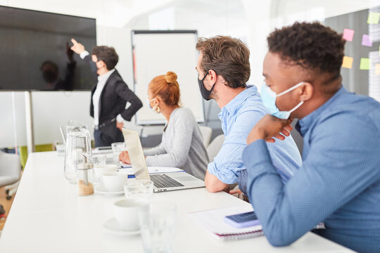 Business people listen to a presentation