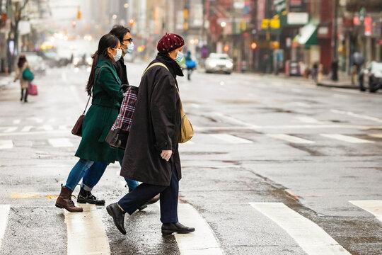 People wearing masks in New York City during covid coronavirus quarantine