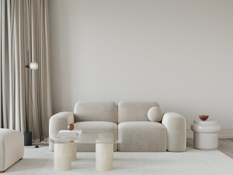 living room in beige tones with a stylish sofa, a glass table…