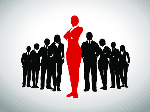 Remarkable Female Leader in front of large team of successful executives. A large team of successful executives in silhouettes led by a great remarkable Female leader in red who stands in front of the