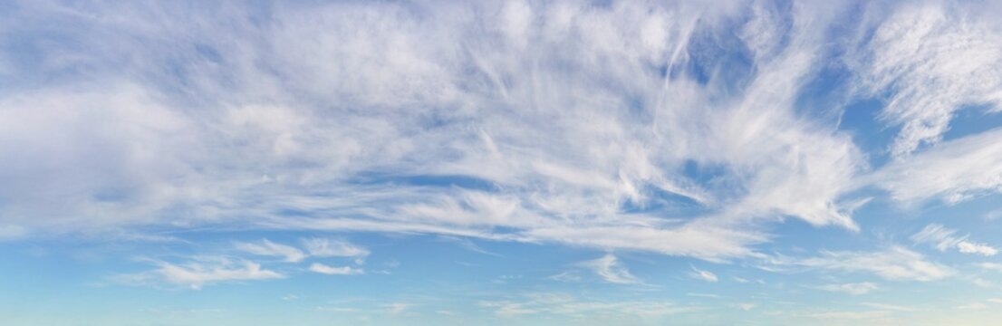 Bright sky background with cirrus clouds above, high resolution image