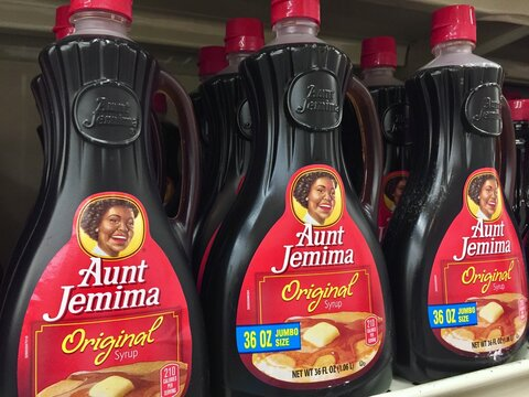 bottles of Aunt Jemima syrup on a store shelf