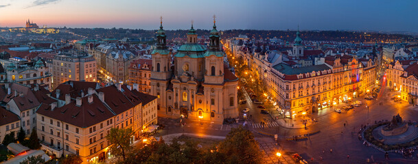 PRAGUE, CZECH REPUBLIC - OCTOBER 17, 2018: The panorama with the St. Nicholas church, Staromestske square and the Old Town at dusk.
