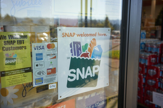 "Portland, OR, USA - Oct 28, 2020: ""SNAP welcomed here"" sign is seen at the entrance to a Big Lots store in Portland, Oregon. The Supplemental Nutrition Assistance Program (SNAP) is a federal program."