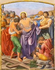 VIENNA, AUSTIRA - OCTOBER 22, 2020: The fresco Jesus clothes are taken away in the church of St. John the Nepomuk by Josef Furlich (1844 - 1846).