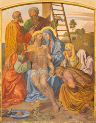 VIENNA, AUSTIRA - OCTOBER 22, 2020: The fresco of Deposition of the Cross (Pieta) as part of Cross way station in the church of St. John the Nepomuk by Josef Furlich (1844 - 1846).
