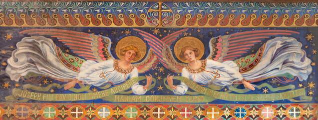 VIENNA, AUSTIRA - OCTOBER 22, 2020: The freso of angels in church Pfarrkirche Kaisermühlen.