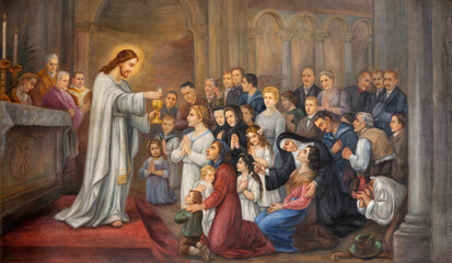 VIENNA, AUSTIRA - OCTOBER 22, 2020: The symbolic fresco Jesus give the communion in church Pfarrkirche Kaisermühlen from end of 19. cent.