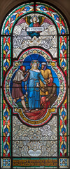 VIENNA, AUSTIRA - OCTOBER 22, 2020: The Jesus clothes are taken away on the stained glass in church Pfarrkirche Kaisermühlen by workroom Tiroler Glasmalerei-Anstalt from end of 19. cent..
